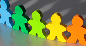 colorful wooden people interacting